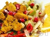 Задушени хапки свинско месо от плешка със зеленчуци (чушки, моркови, гъби, праз лук) и куркума на тиган